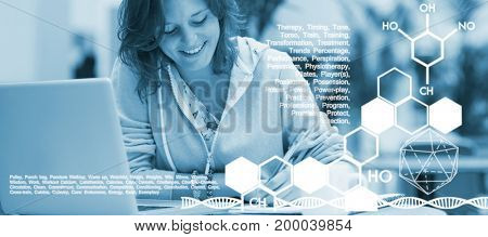 Illustrative image of blue text against cheerful student doing homework by laptop at cafeteria table