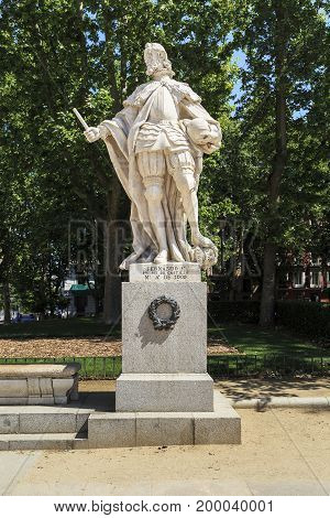 MADRID, SPAIN - MAY 24, 2017: It is the limestone statue of Spanish king Fernando I on Plaza Oriente.