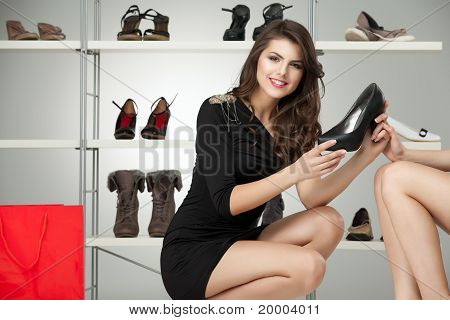 Two Young Women Trying On High Heels