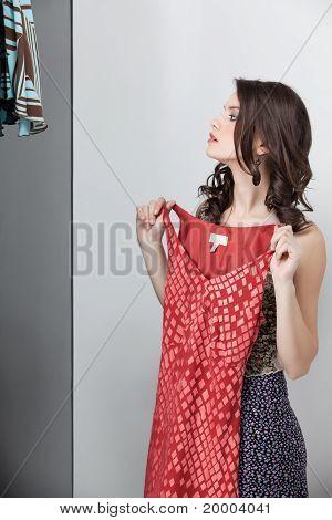 Brunette Trying On Red Dress