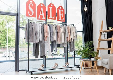 Rack With Hanging Clothes In Store