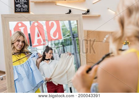view of young beautiful women in clothes store