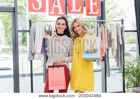 Young Beautiful Women With Shopping Bags In Clothes Store