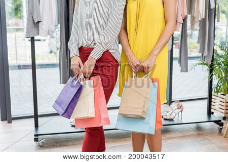 Cropped Shot Of Women With Shopping Bags In Clothes Store