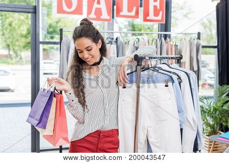 Beautiful Shopaholic Woman With Shopping Bags In Clothes Store