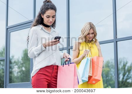 Beautiful Women On Shopping Outdoors With Bags