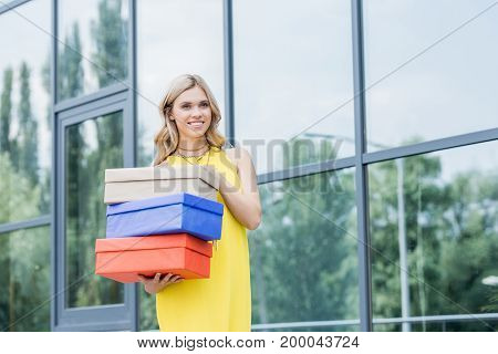 Beautiful Happy Blonde Woman With Shoe Boxes