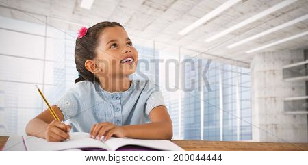 Girl looking up while sitting at desk against modern room overlooking city