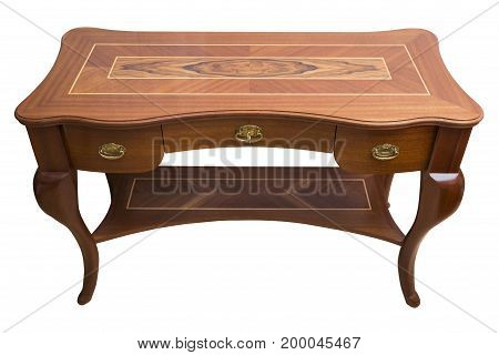Antique wooden handcrafted table with gold metal handles and shelves with a patterned decorative types of wood on isolated white background