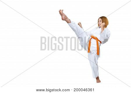 On a white background the girl beats a high kick