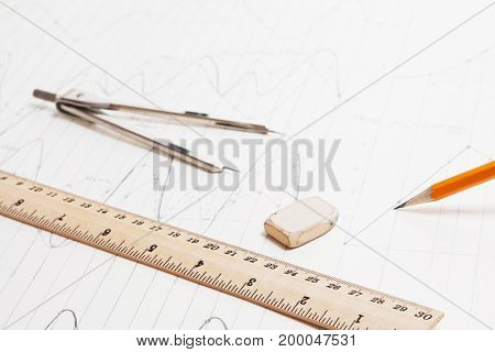 Old hand drawing design detail and drawing tools: ruler, pencil, eraser close up background
