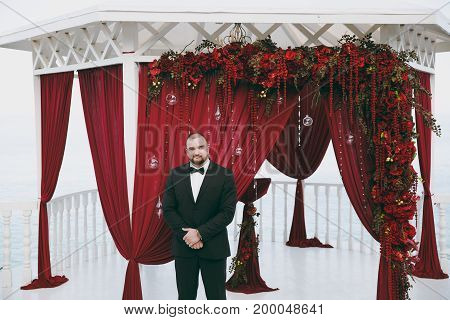 Groom In A Suit And A Bow Tie On The Wedding Ceremony