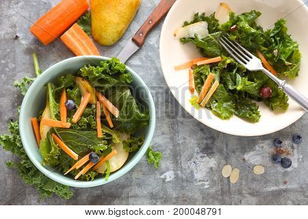 Kale salad with grated carrot and pear.