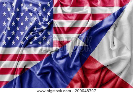 Ruffled waving United States of America and Texas flag