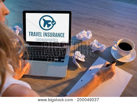 Digital composite of Woman using a computer with travel insurance concept on screen