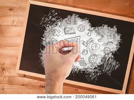 Digital composite of Hand drawing education graphics on blackboard