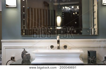 Expensive Bathroom Sink And Mirrored Cabinet