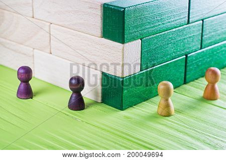 Unexpected meeting business competition. Strangers at a bend an abstract composition of wooden blocks.