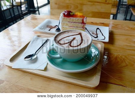 A Cup Of Coffee And Cake  On  Wooden Table