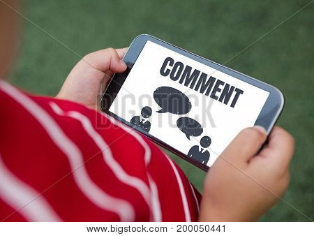 Digital composite of Comment text and chat graphic on phone screen with hands