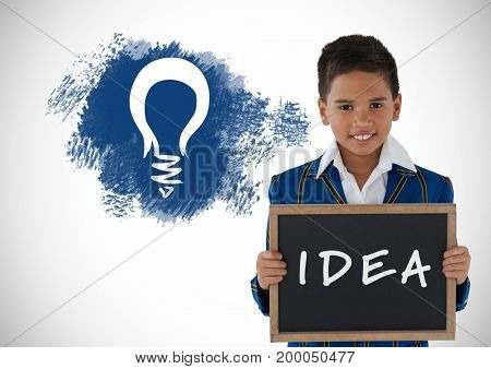 Digital composite of Boy holding blackboard with idea text and light bulb graphics