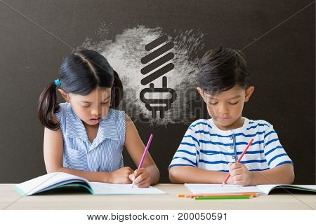 Digital composite of Students at table writing against grey blackboard with school and education graphic