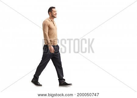 Full length profile shot of a young guy walking isolated on white background