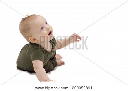 Adorable surprised baby boy on white background. Funny laughing infant kid laying on the white blanket.