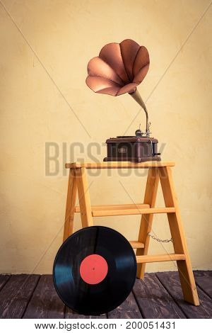 Vintage gramophone and vinyl disk. Retro music concept