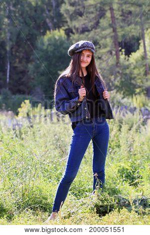 Beautiful fashion girl on background of countryside