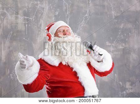 Santa Claus singing Christmas songs on grunge background