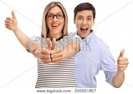 Joyful young man and woman holding their thumbs up isolated on white background