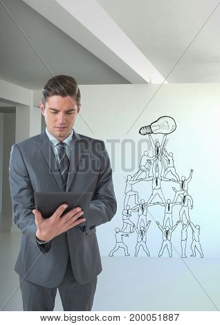 Digital composite of Business man using a tablet in a 3D room with a conceptual graphic on the wall