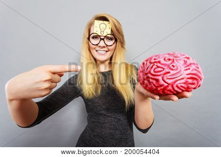 Weird Woman Holding Brain Having Idea