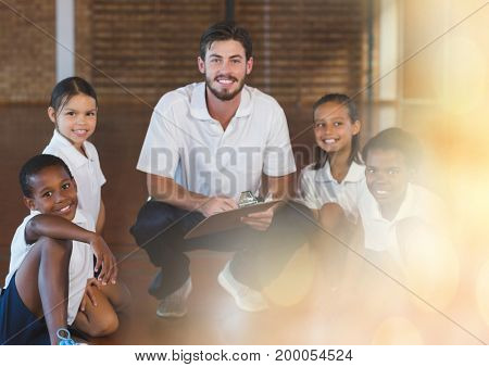 Digital composite of Physical education teacher with class