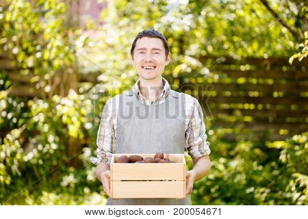 Farmer with box of potatoes