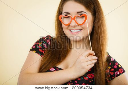 Happy Woman Holding Fake Eyeglasses On Stick