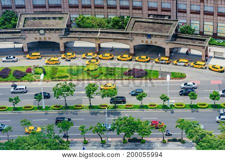 TAIPEI TAIWAN - JUNE 24: This is an aerial view of a Banqiao station taxi rank and the busy city road with cars driving passed on June 24 2017 in Taipei