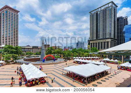 TAIPEI TAIWAN - JUNE 24: This is a view of Citizen square a public space where events are held and many downtown office buildings can be seen on June 24 2017 in Taipei