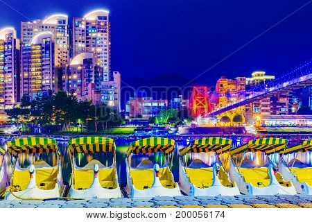Xindian riverside park night view with boats