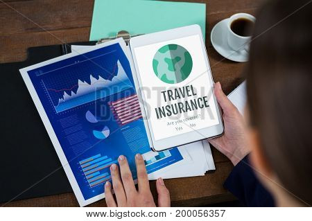 Digital composite of Woman holding a tablet with travel insurance concept on screen