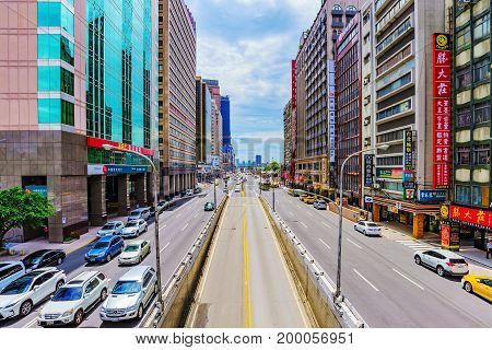 TAIPEI TAIWAN - JUNE 20: This is a city road with tall office buildings in the downtown area near Taipei main station on June 20 2017 in Taipei