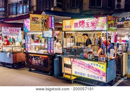 TAIPEI TAIWAN - JUNE 19: These are food stalls in Raohe street night market stalls like these are very common in Taiwanese night markets on June 19 2017 in Taipei