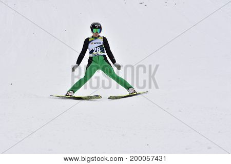 Rasnov, Romania - February 7: Unknown Ski Jumper Competes In The Fis Ski Jumping World Cup Ladies On
