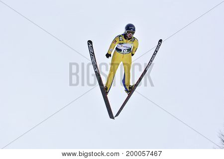 Rasnov, Romania - February 8: Unknown Ski Jumper Competes In The Fis Ski Jumping World Cup Ladies On