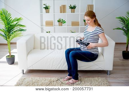 Pregnant woman playing music to her baby