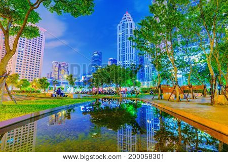 TAIPEI TAIWAN - JUNE 08: This is a park in Banqiao near Citizen square where you can see many office buildings and skyscrapers on June 08 2017 in Taipei
