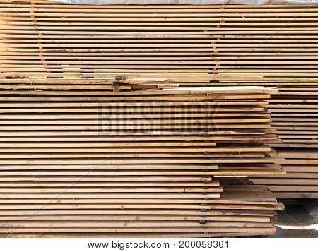 Cut wood spruce boards. Timber, planed boards. Carpenter texture and background. Wooden material for construction industrial.