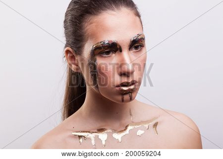 Beautiful young woman with amazing creative make up on white background in studio photo