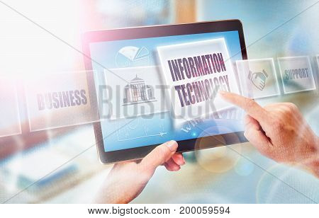 A Businesswoman Selecting A Information Technology Business Concept On A Futuristic Portable Compute
